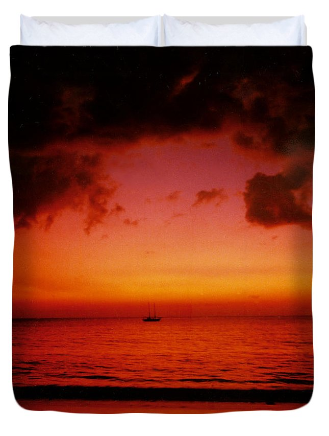 Sunset Duvet Cover featuring the photograph Solo by Kurt Van Wagner
