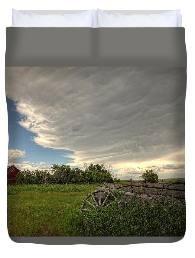 Light Duvet Cover featuring the photograph Storm Clouds Gather Over An Abandoned by Robert Postma