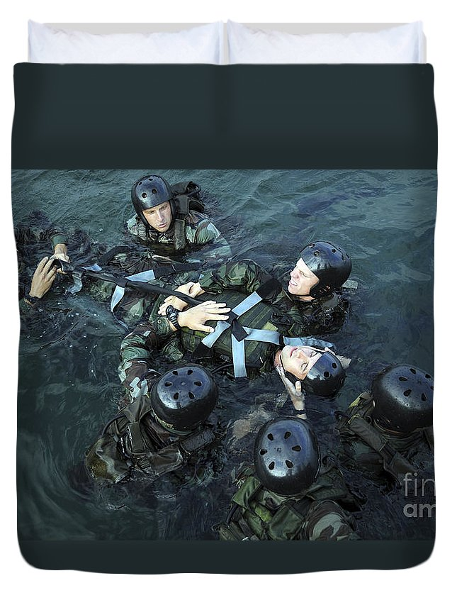 Navy Seals Duvet Cover featuring the photograph Students Secure A Simulated Casualty by Stocktrek Images