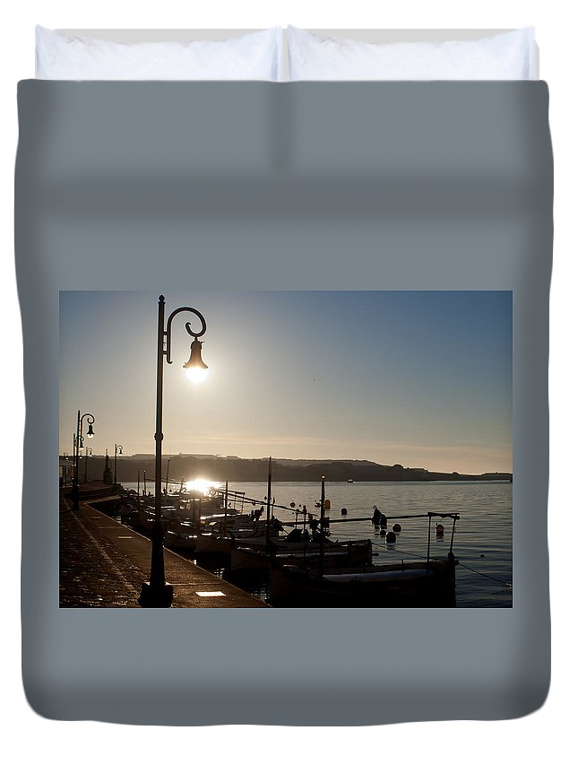 Spain Duvet Cover featuring the photograph sunrise - First dawn of a spanish town is Es Castell Menorca sun is a special lamp by Pedro Cardona Llambias