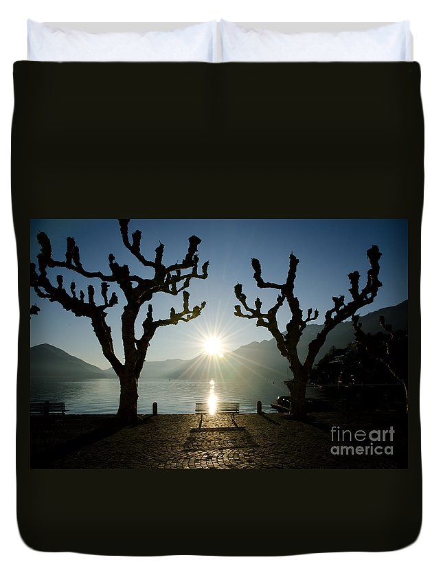 Bench Duvet Cover featuring the photograph Sunset Over A Lake With Trees by Mats Silvan