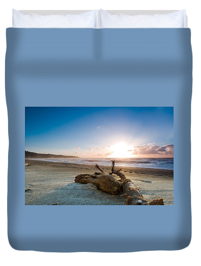 Beach Duvet Cover featuring the photograph Sunset Over A Misty Beach by U Schade