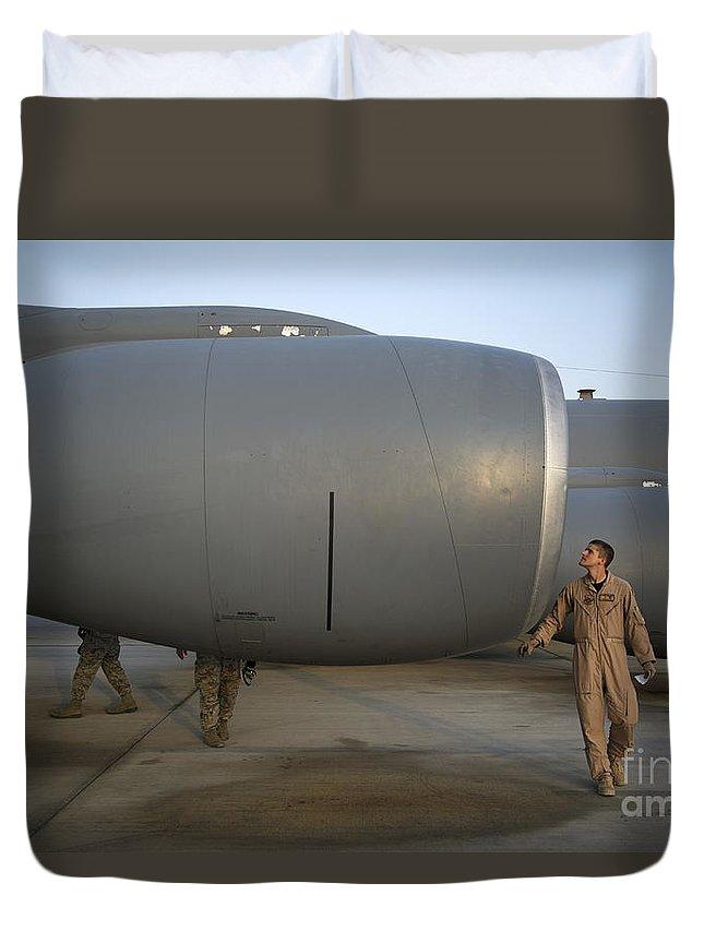 Kc-135 Duvet Cover featuring the photograph Technician Performs A Preflight by Stocktrek Images