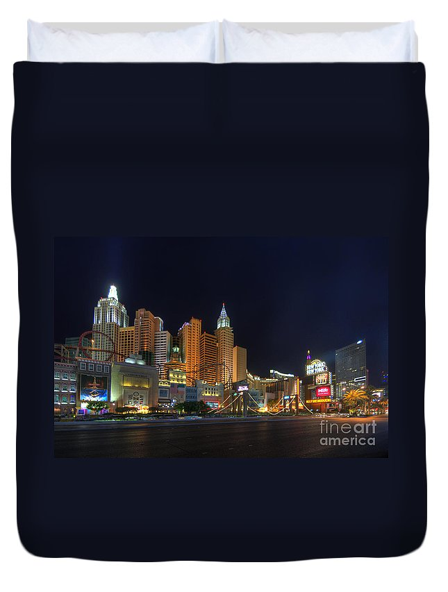 Art Duvet Cover featuring the photograph The Strip by Yhun Suarez
