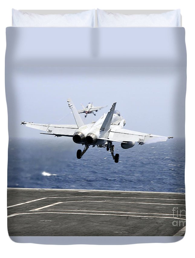 Aircraft Carrier Duvet Cover featuring the photograph Two Fa-18c Hornet Strike Fighters by Stocktrek Images