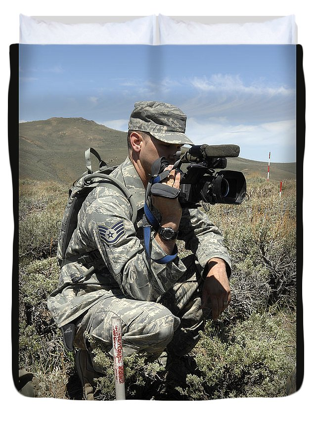 Us Air Force Duvet Cover featuring the photograph U.s. Air Force Sergeant Shoots Video by Stocktrek Images