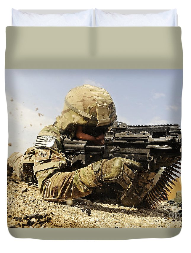 Security Forces Duvet Cover featuring the photograph U.s. Air Force Soldier Fires The Mk48 by Stocktrek Images