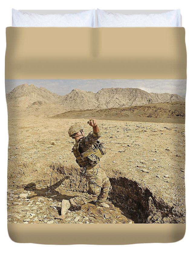 Security Forces Duvet Cover featuring the photograph U.s. Air Force Soldier Throws A Frag by Stocktrek Images
