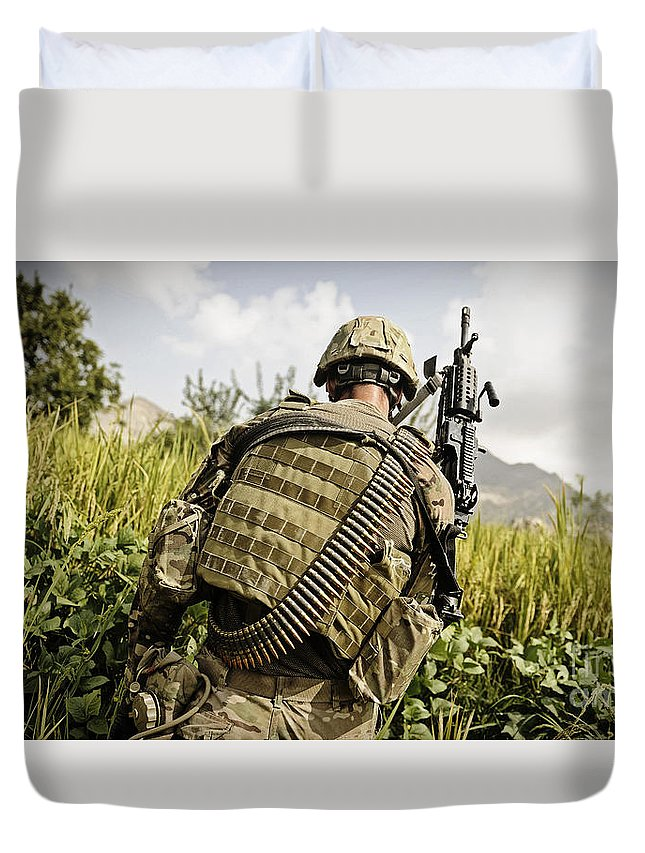 Operation Enduring Freedom Duvet Cover featuring the photograph U.s. Army Mk48 Machine Gunner Patrols by Stocktrek Images