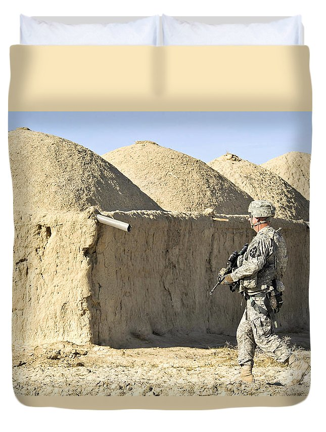 Village Duvet Cover featuring the photograph U.s. Army Soldier Conducts A Dismounted by Stocktrek Images