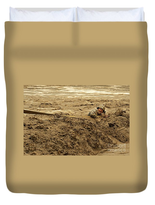 Army Duvet Cover featuring the photograph U.s. Army Soldier Fights Racing Water by Stocktrek Images