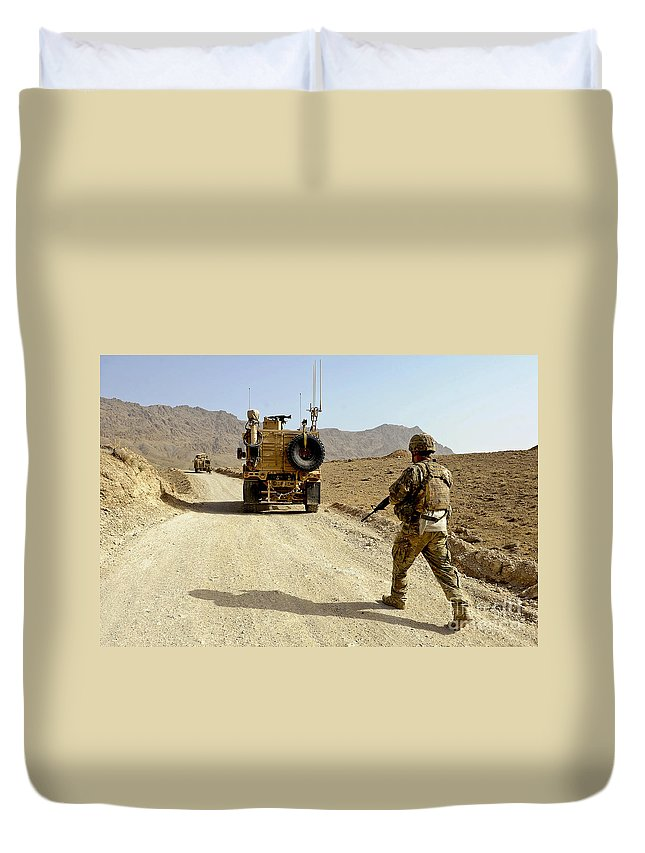Provincial Reconstruction Team Duvet Cover featuring the photograph U.s. Army Soldier Moves To His Mrap by Stocktrek Images