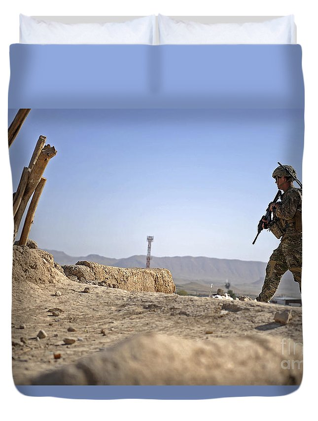 Provincial Reconstruction Team Duvet Cover featuring the photograph U.s. Army Soldier On A Foot Patrol by Stocktrek Images
