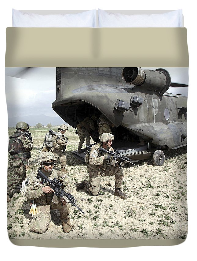 Afghanistan Duvet Cover featuring the photograph U.s. Army Soldiers Board A Ch-47 by Stocktrek Images