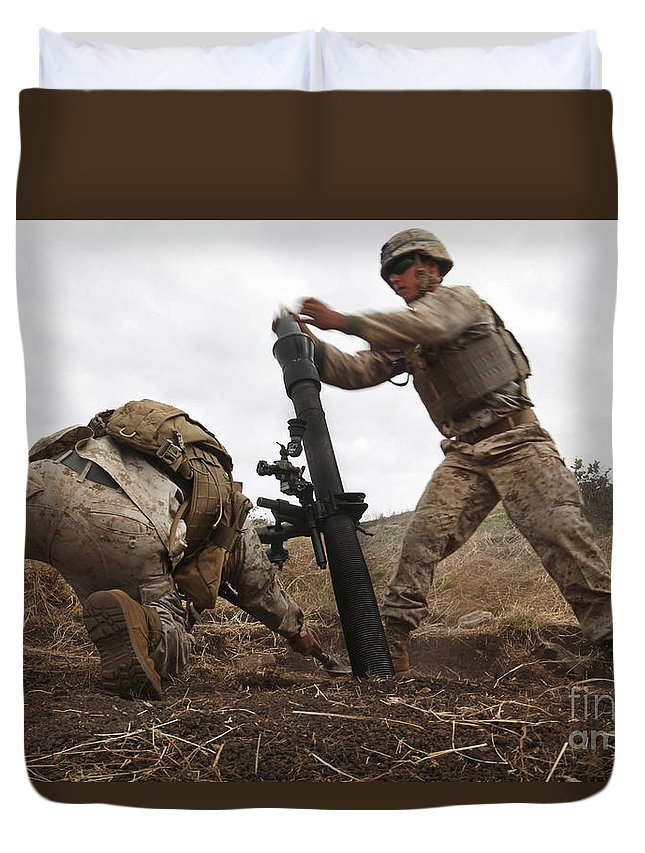 Bending Over Duvet Cover featuring the photograph U.s. Marine Drops A Mortar Round by Stocktrek Images