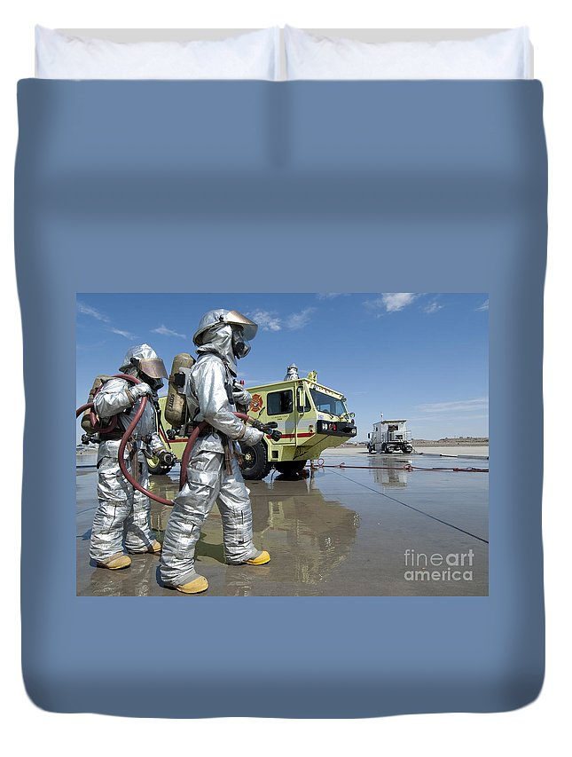 Protective Clothing Duvet Cover featuring the photograph U.s. Marine Firefighters Stand Ready by Stocktrek Images