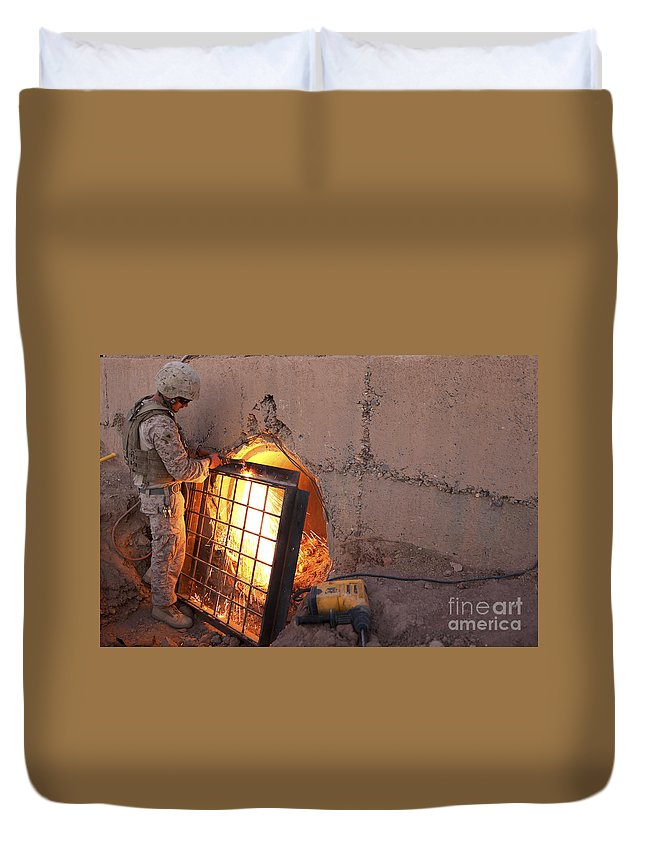 Middle East Duvet Cover featuring the photograph U.s. Marine Places A Cage by Stocktrek Images