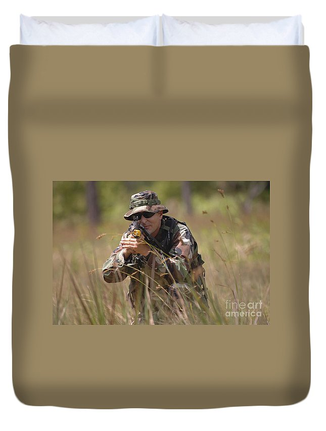 Aiming Duvet Cover featuring the photograph U.s. Navy Diver Engages The Target by Stocktrek Images