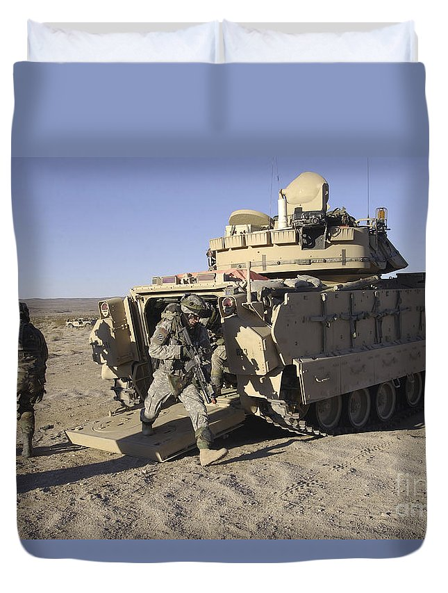Army Duvet Cover featuring the photograph U.s. Soldiers Exit From An M2 Bradley by Stocktrek Images