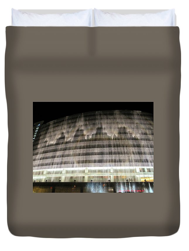 Water Cascades Down Hotel Facade Duvet Cover featuring the photograph Water Cascade Over Building by Sally Weigand