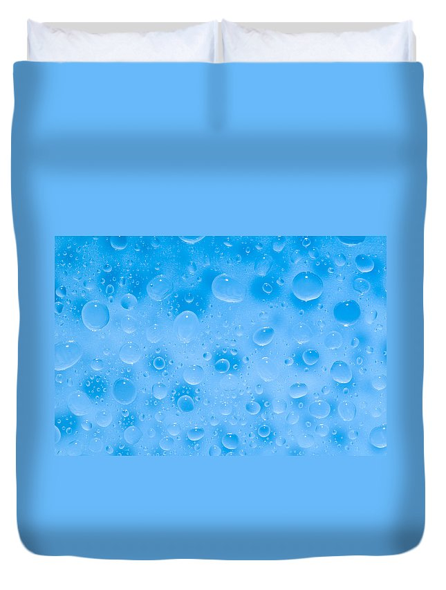 Abstract Duvet Cover featuring the photograph Water Drops On A Surface by U Schade