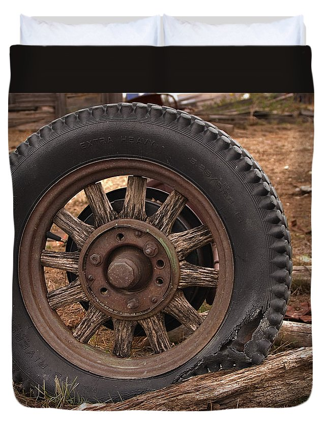 Rubber Duvet Cover featuring the photograph Wooden Spoked Tire by Grant Groberg