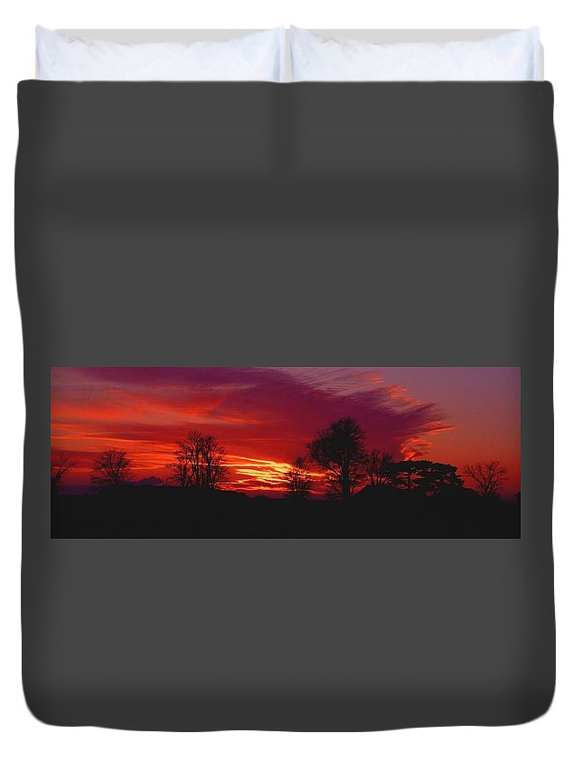 Sunset Duvet Cover featuring the photograph 022107-37 by Mike Davis