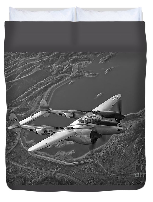 Black And White Duvet Cover featuring the photograph A Lockheed P-38 Lightning Fighter by Scott Germain