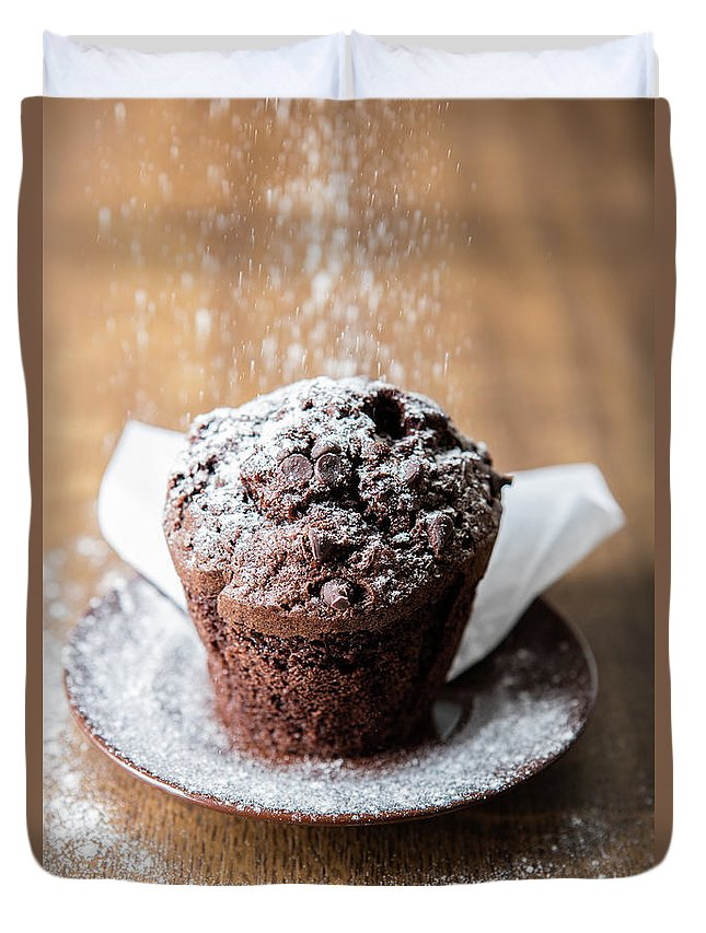 Muffin Duvet Cover featuring the photograph Chocolate Muffin With Powdered Sugar by Piotr Marcinski