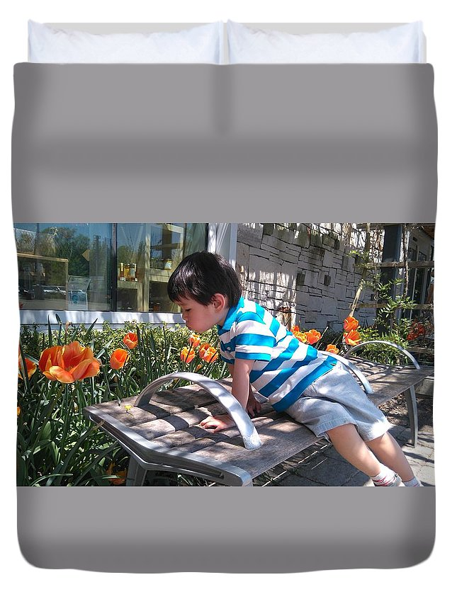Little Boy Looking At Flower Bed Duvet Cover featuring the photograph Little Boy And Flowers by Connie Du