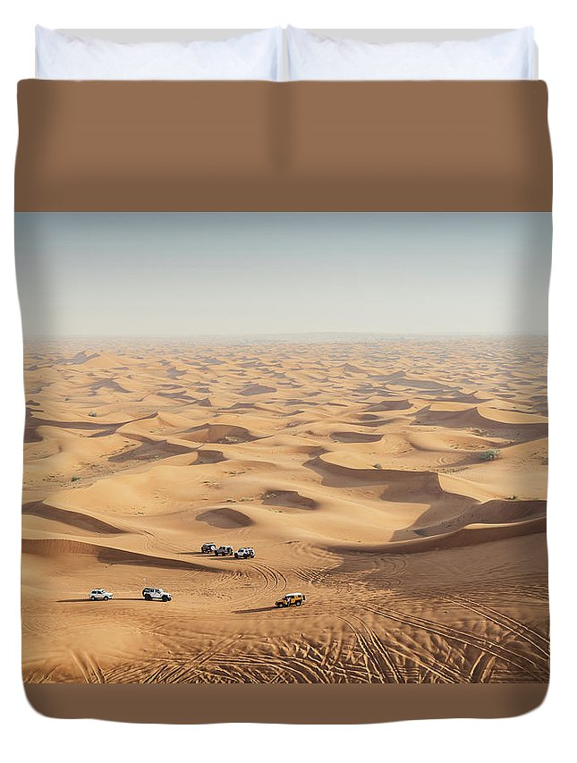4x4 Duvet Cover featuring the photograph One 4x4 Vehicle Off-roading In The Red Sand Dunes Of Dubai Emirates, United Arab Emirates by Alexandre Rotenberg