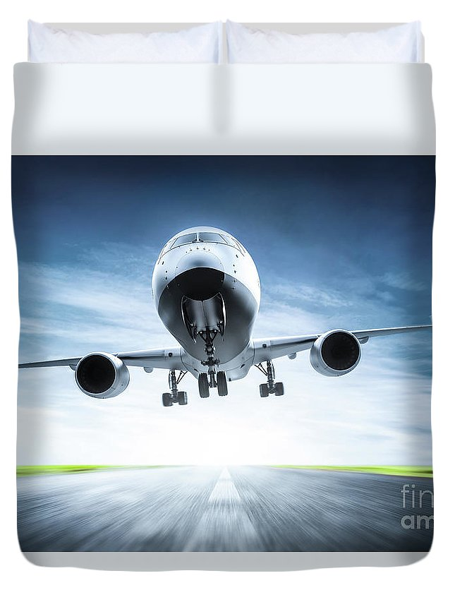 Airplane Duvet Cover featuring the photograph Passenger Airplane Taking Off On Runway by Michal Bednarek