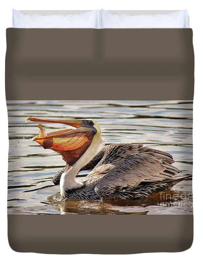 Pelican Duvet Cover featuring the photograph Pelican Catching A Fish by Paulette Thomas