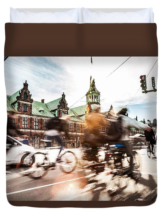 Copenhagen Duvet Cover featuring the photograph People Cycling In Copenhagen by Leonardo Patrizi