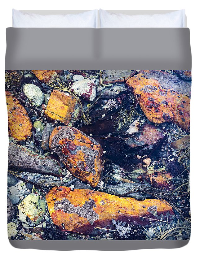 Beach Duvet Cover featuring the photograph Small Rocks On The Beach by Enrico Della Pietra