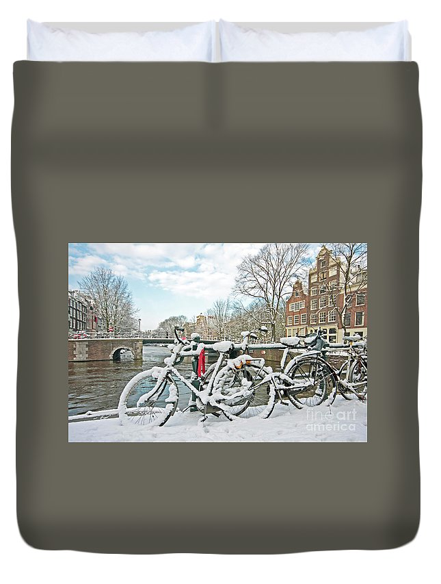 Amsterdam Duvet Cover featuring the photograph snowy Amsterdam in the Netherlands by Nisangha Ji