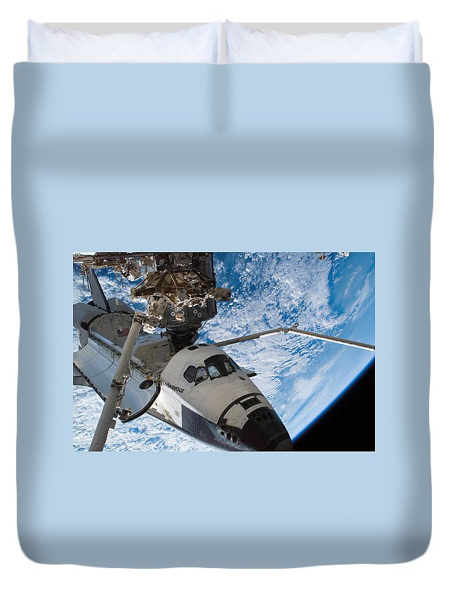 Canadarm2 Duvet Cover featuring the photograph Space Shuttle Endeavour, Docked by Stocktrek Images