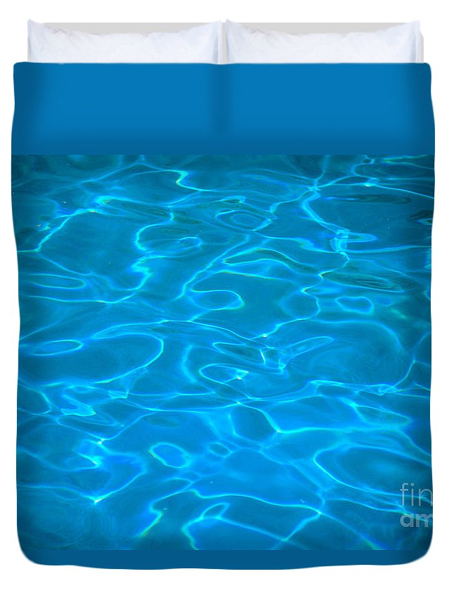 Blue Duvet Cover featuring the photograph Surface Ripples by Himani - Printscapes