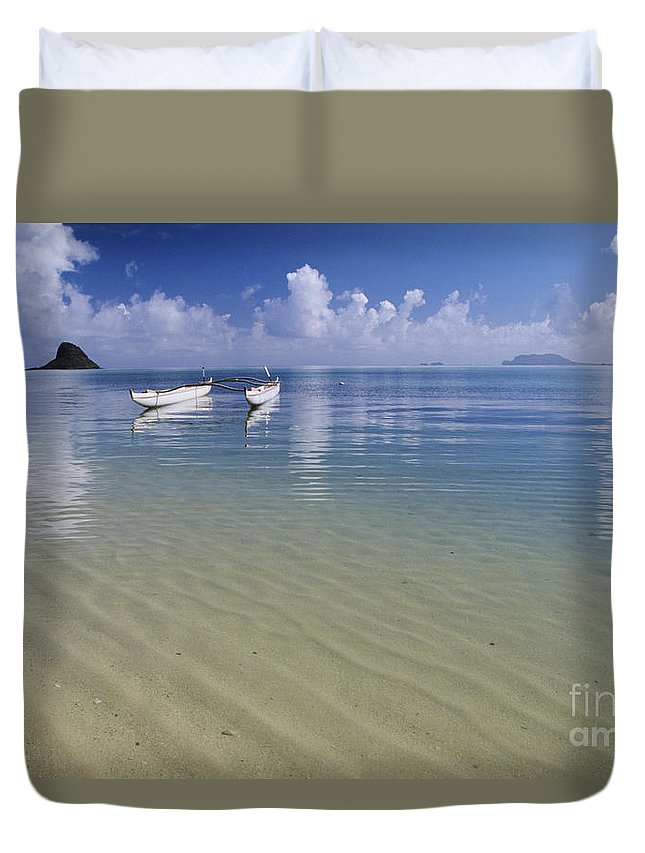 Aku Duvet Cover featuring the photograph White Double Hull Canoe by Joss - Printscapes