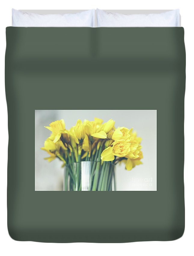 Yellow Duvet Cover featuring the photograph Yellow Narcissuses Bouquet In A Glass Vase by Dvoevnore Photo