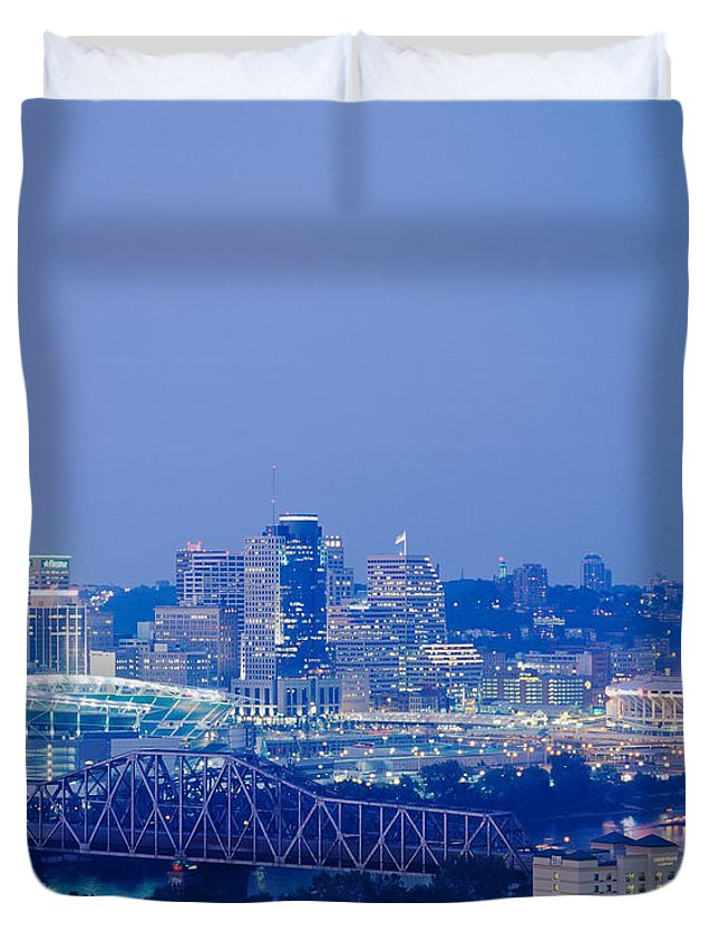 Photography Duvet Cover featuring the photograph Buildings In A City Lit Up At Dusk by Panoramic Images