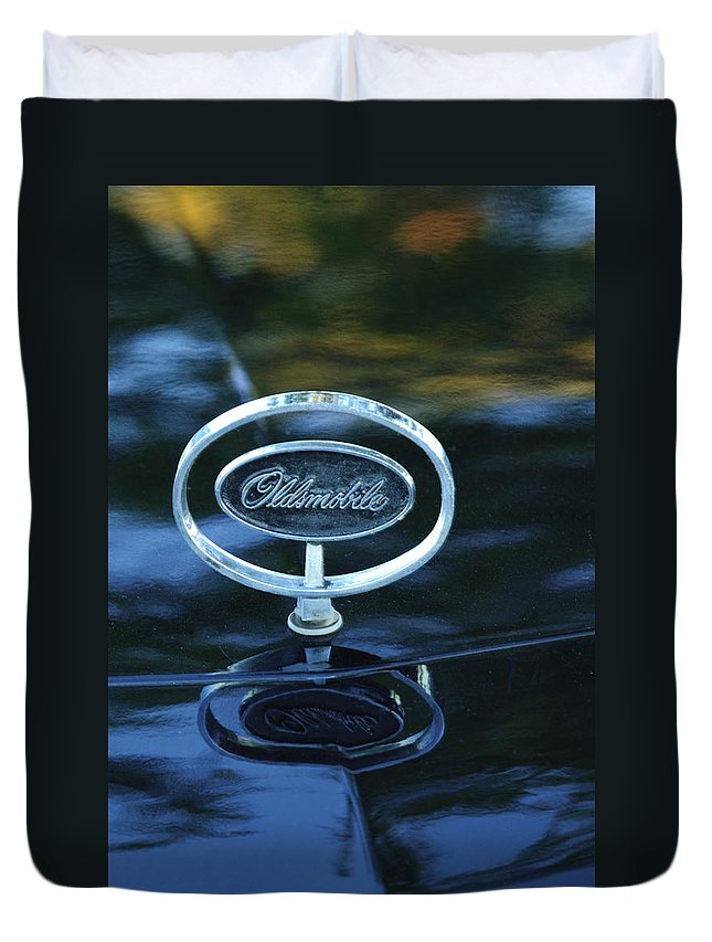 1975 Oldsmobile Duvet Cover featuring the photograph 1975 Oldsmobile Hood Ornament by Jill Reger