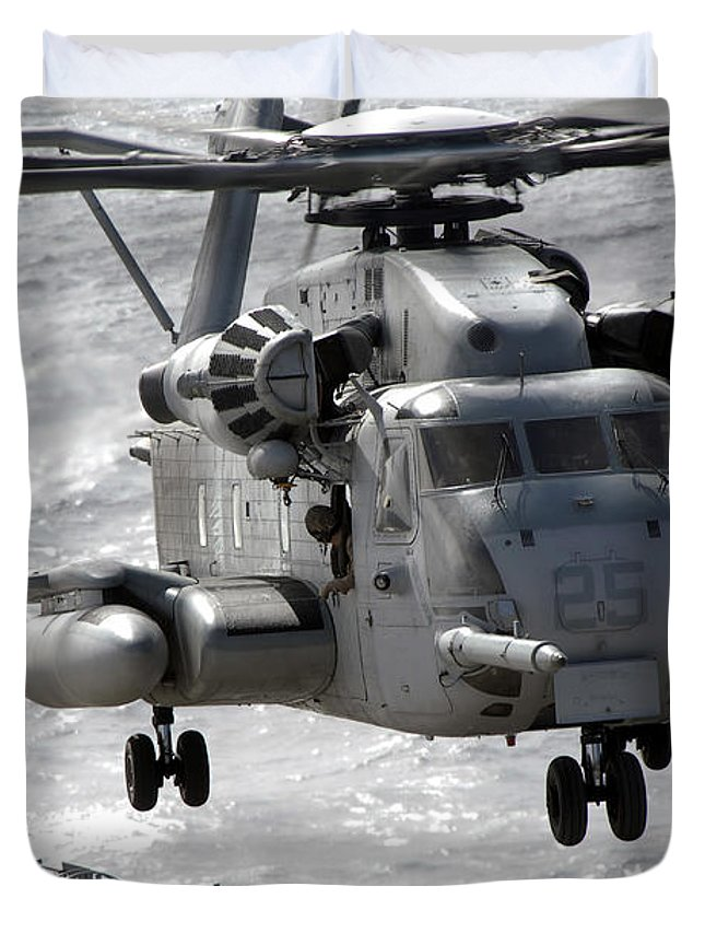 Helicopter Duvet Cover featuring the photograph A Ch-53e Super Stallion Helicopter by Stocktrek Images