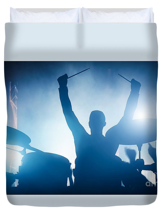 Drums Duvet Cover featuring the photograph Drummer playing on drums on music concert. Club lights by Michal Bednarek