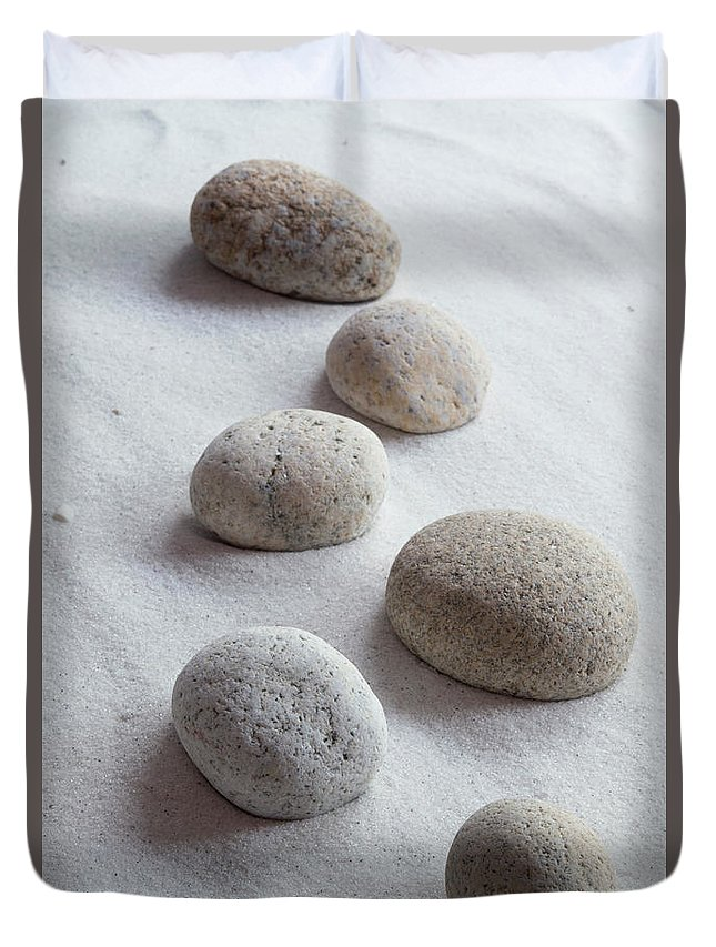 Meditation Duvet Cover featuring the photograph Meditation Stones On White Sand by Michelle Himes