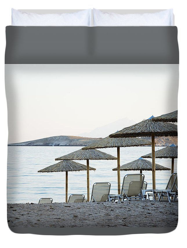 Beach Duvet Cover featuring the photograph Parasol And Sunbeds At Sunset by Newnow Photography By Vera Cepic