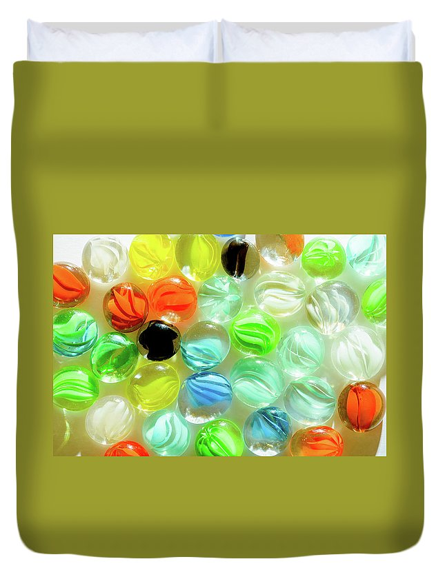 Abstract Duvet Cover featuring the photograph Colored Glass Beads On White Background by Alain De Maximy