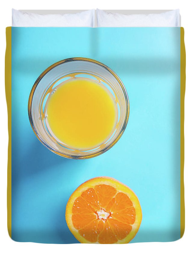 Glass Duvet Cover featuring the photograph Glass Of Orange Juice And Half Of Orange by Piotr Marcinski