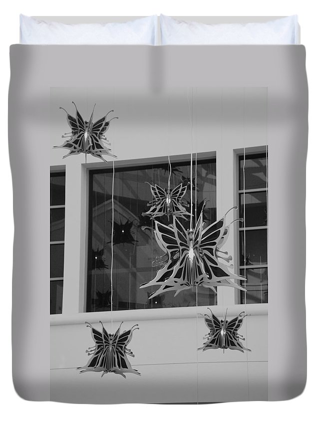 Black And White Duvet Cover featuring the photograph Hanging Butterflies by Rob Hans