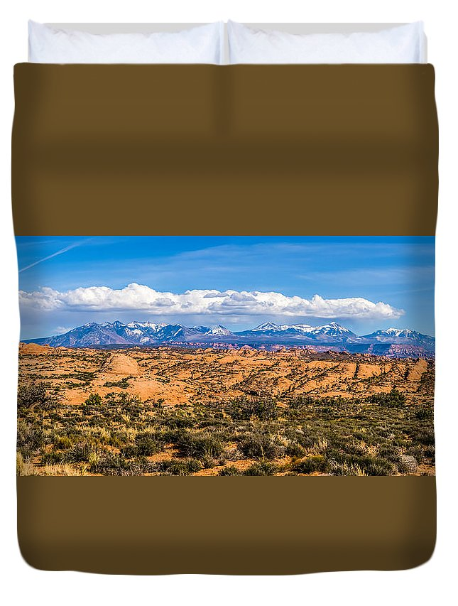 Snow Duvet Cover featuring the photograph Canyon Badlands And Colorado Rockies Lanadscape by Alex Grichenko